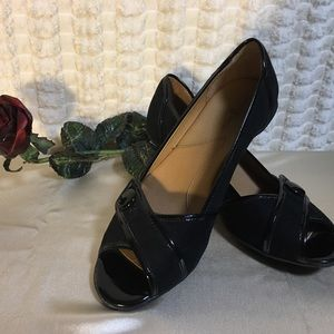 Black patten leather open toe pumps. Jaclyn Smith